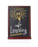 Learning alphabet with bulb idea on chalkboard Royalty Free Stock Photo