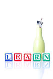 Learning Art. Wooden Blocks Spelling Learn With Vase Full Of Paintbrushes Royalty Free Stock Image