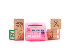 Learning Basic Math. With Wooden Number Blocks And A Calculator royalty free stock photo
