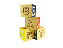 Learning blocks arrange in a pyramid. Form a baby word on the white background Stock Images
