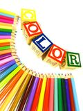 Learning blocks in color and color pencils. Learning blocks arranged in a line color and color pencils Stock Images