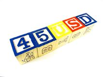 Learning blocks make 45 USD line. Learning blocks arranged in a line making 45 USD on white background Stock Images