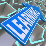 Learning blue arrow Stock Photo
