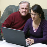 Learning computers. A middle-aged couple learning to use a laptop computer Stock Photos