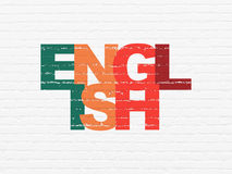 Learning concept: English on wall background. Learning concept: Painted multicolor text English on White Brick wall background, 3d render Royalty Free Stock Photography