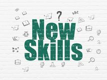 Learning concept: New Skills on wall background Royalty Free Stock Images