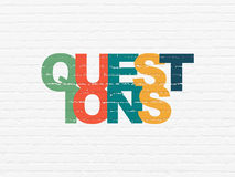 Learning concept: Questions? on wall background Stock Photo
