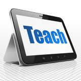 Learning concept: Tablet Computer with Teach on display. Learning concept: Tablet Computer with blue text Teach on display, 3D rendering Royalty Free Stock Image