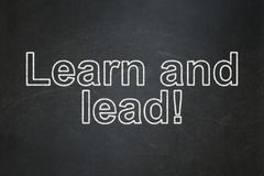 Learning concept: Learn and Lead! on chalkboard background. Learning concept: text Learn and Lead! on Black chalkboard background Stock Images