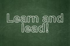 Learning concept: Learn and Lead! on chalkboard background. Learning concept: text Learn and Lead! on Green chalkboard background Royalty Free Stock Photos
