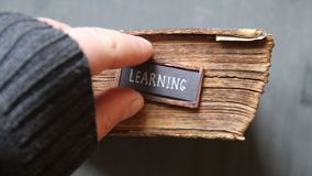 Learning concept, vintage book and text. Learning concept, old book on a wooden background and text stock video