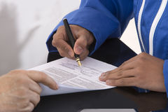 Learning contract signature Stock Photo