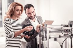 Creative designers learning printing models on 3D printer. Always learning. Creative talented designers learning printing models on 3D printer reading royalty free stock photos