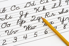 Learning cursive writing. Example of cursive writing with a pencil, Learning cursive writing stock photos