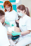 Learning dental procedures from a professional royalty free stock photos