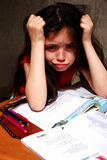 Learning difficulty?. 8 years old girl struggles with homeworks royalty free stock images