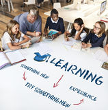 Learning Education Academics Concept. A group of elementary student study on project at the library with the teacher Royalty Free Stock Photos