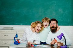 Learning and education concept. Happy family. Mother father and son together schooling. Boy from elementary school. Learning and education concept. Happy family royalty free stock photos