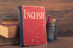 Learning english concept. Book on a wooden background Royalty Free Stock Images