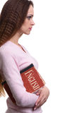 Learning English concept. Girl holds a book Stock Photography