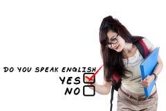 Learning english language 3. Learning language concept. Female student write Do You Speak English Stock Photography