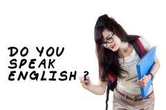 Learning english language. Learning language concept. Female student write Do You Speak English Royalty Free Stock Image