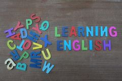 Learning english text with colored wooden letters royalty free illustration