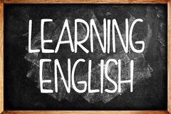 Learning English title on Language School Blackboard Royalty Free Stock Photos