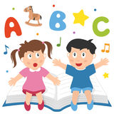 Learning Is Fun. Two happy kids having fun and learning, sitting on a big book. Eps file available Stock Photo