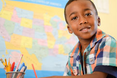Learning is Fun. An African American boy in school smiling at camera Royalty Free Stock Photos