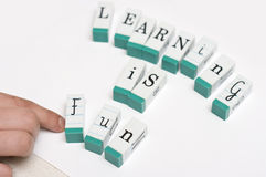 Learning is fun. Message 'learning is fun' arranged with letter blocks on white background Stock Image