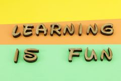Learning fun letters wooden colors. Learning is fun colors wood letters words capital spelling wooden written script expression message royalty free stock photography
