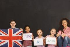 Learning through fun. Teacher learning kids english through fun Stock Photos