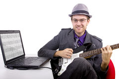 Learning Guitar Online Royalty Free Stock Photography