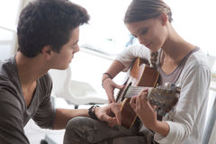 Learning the guitar Royalty Free Stock Photography