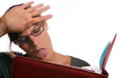 Learning Is Hard!. A young woman is learning hard for a test Stock Photography