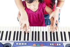 Learning how to play piano Royalty Free Stock Photo