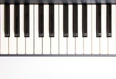 Learning how to play piano Stock Images