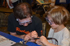 Learning how to solder at the Ann Arbor mini Maker Faire Royalty Free Stock Photos