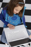 Learning how  use a laptop Stock Photo