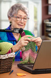 Learning knit in 70 year old Stock Images