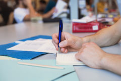 Learning languages. Concept, close up hand of the student writing in notepad Stock Images