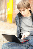 Learning male student working on laptop Stock Photography