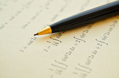 Learning math. Closeup of mathematical lessons on differential and integral calculus royalty free stock image