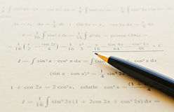 Learning math. Closeup of mathematical lessons on differential and integral calculus royalty free stock photo