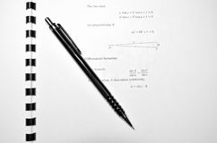 Learning math. Pencil and mathematical book on some kind of geometry stock photography