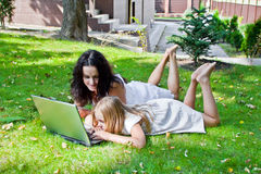 Learning mother and daughter Royalty Free Stock Photo