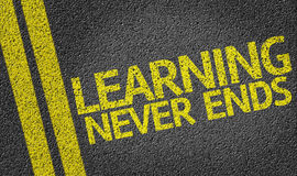 Learning Never Ends written on the road Stock Photography