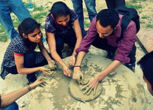 Learning old tricks. Art students in India learning clay pot making on a wheel royalty free stock image