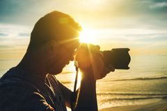 Learning Photography. At Sunset. Photographer Practicing Taking Pictures Royalty Free Stock Image